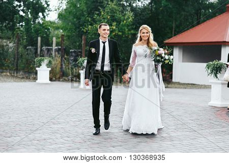 Romantic Happy Couple, Bride & Groom Walking To Aisle