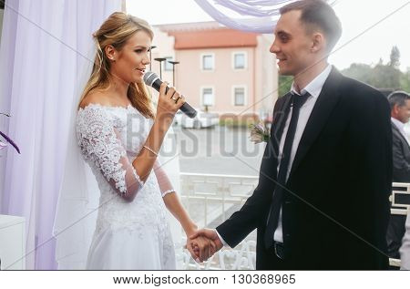 Beautiful Blonde Bride & Groom Taking Vows At Wedding Ceremony