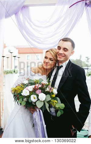 Romantic Happy Couple, Bride & Groom Posing At Wedding Aisle