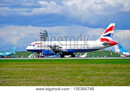 SAINT PETERSBURG RUSSIA - MAY 11 2016. British Airways Airbus A320 airplane -registration number G-EUUC. Airplane rides on the runway after arrival in Pulkovo International airport