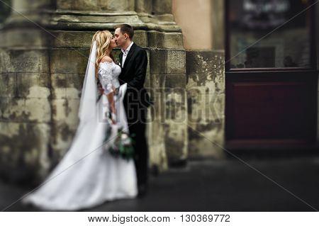 Romantic Newlyweds Hugging In Old European Street