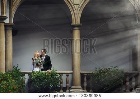 Beautiful Traveler Newlywed Couple Posing On Italian Balcony