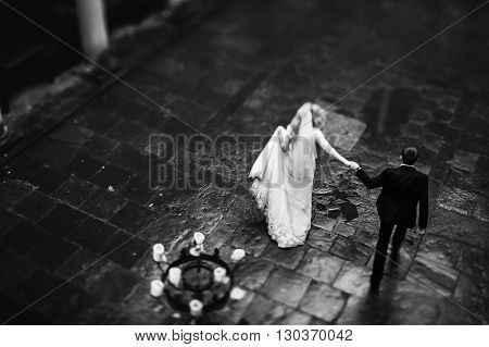 Romantic Newlywed Couple Dancing In Italian Street, Column Balcony Background B&w