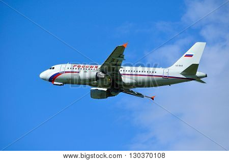 SAINT PETERSBURG RUSSIA - MAY 11 2016. Rossiya Airlines Airbus A319 airplane -registration number VQ-BAR - is flying in the sky after departure from Pulkovo International airport