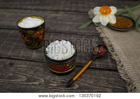 The cheese and sour cream in a bowl with Khokhloma painting