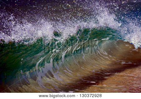 A Wave Smashing On The Sand Shore