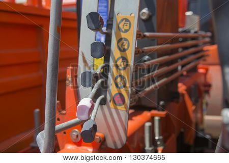 Mechanical levers of switching on control panel of lifting mechanism