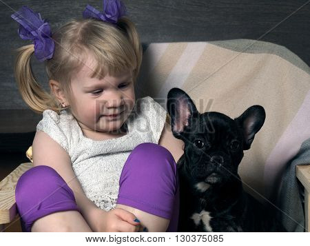 Little girl with a dog. Portrait of a child with a dog