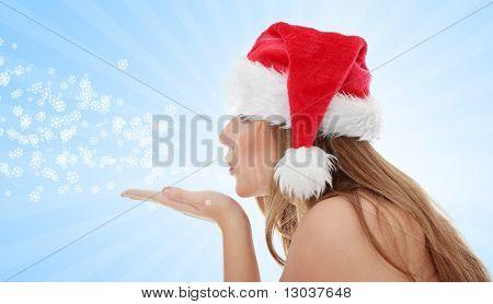 Christmas woman wearing a santa hat sendind a kiss