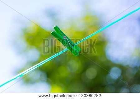 Plastic Washing Line And Clothespins On Natural Background