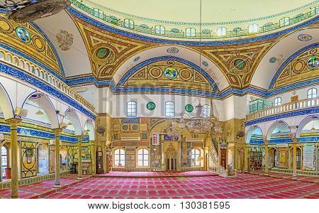 ACRE ISRAEL - FEBRUARY 20 2016: The interior of Al-Jazzar mosque decorated with the stone patterns and inscriptions of Quran on February 20 in Acre.