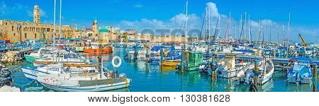 ACRE ISRAEL - FEBRUARY 20 2016: Panorama of the old port of Akko with its medieval architecture and Sinan Basha Sea Mosque on February 20 in Acre.