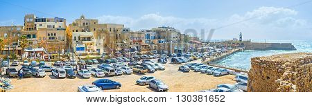ACRE ISRAEL - FEBRUARY 20 2016: The high city ramparts serve as the perfect viewpoint overlooking the medieval housing the other sea walls and the lighthouse on February 20 in Acre.