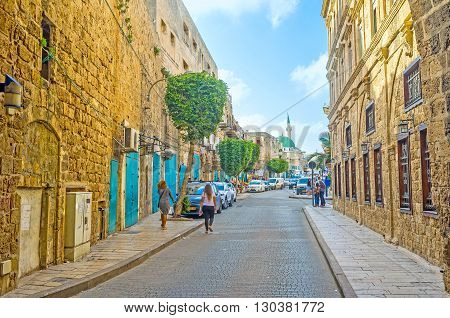 ACRE ISRAEL - FEBRUARY 20 2016: The old Salah Al-Din street is the entrance to the old town through the stone walls on February 20 in Acre.