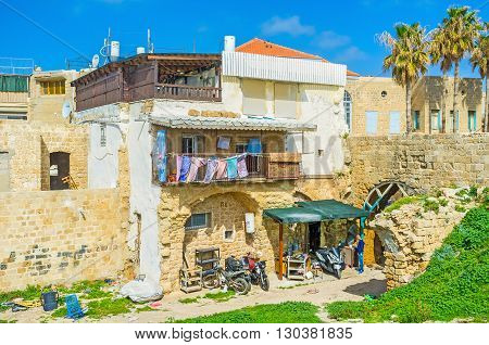 ACRE ISRAEL - FEBRUARY 20 2016: The small garage in the yard of the old stone house here locals repair their bikes on February 20 in Acre.