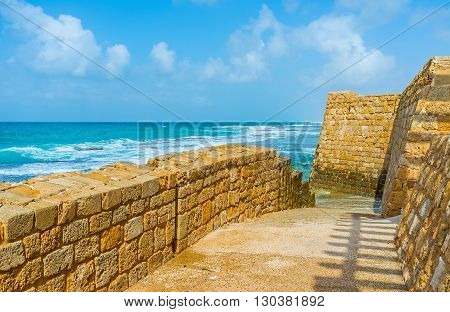 The old sea walls separates the promenade from the coast Acre Israel.