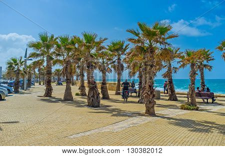 ACRE ISRAEL - FEBRUARY 20 2016: The seaside promenade is the scenic location the best choice for romantic walks on February 20 in Acre.