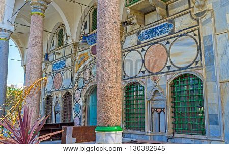 ACRE ISRAEL - FEBRUARY 20 2016: The entrance to Al-Jazzar mosque decorated with the massive stone columns geometric patterns and arabic calligraphy on February 20 in Acre.