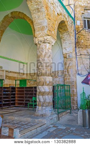 ACRE ISRAEL - FEBRUARY 20 2016: The old carved column in the courtyard of E-Zaitune Mosque on February 20 in Acre.