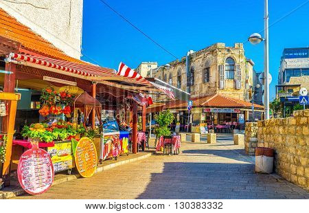 TEL AVIV ISRAEL - FEBRUARY 25 2016: The old town of Jaffa is full of colorful cozy cafes offering the best dishes of the local cuisine on February 25 in Tel Aviv.