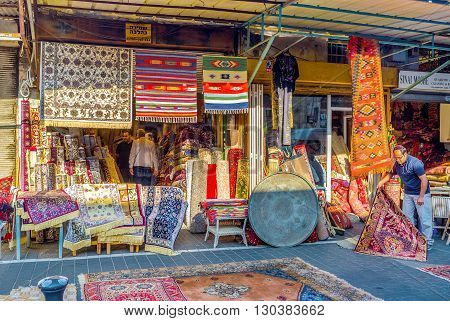 TEL AVIV ISRAEL - FEBRUARY 25 2016: The rug store in the flea market of Jaffa is the best place to choose new or used kilim or watch the making of rug patchwork on February 25 in Tel Aviv.