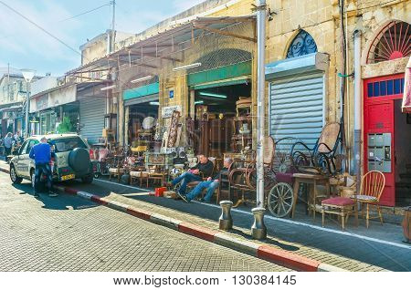 TEL AVIV ISRAEL - FEBBRUARY 25 2016: The whole street of used furniture stores in the large flea market in old Jaffa on February 25 in Tel Aviv.