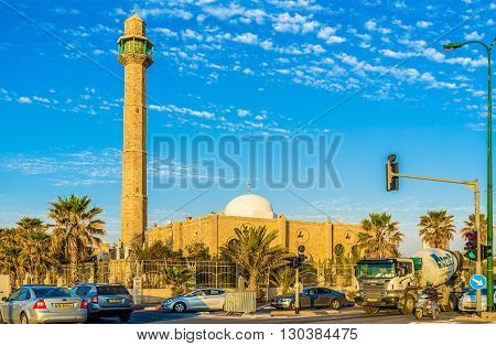 TEL AVIV ISRAEL - FEBBRUARY 25 2016: The medieval Hassan Bek Mosque surronded by green palms on February 25 in Tel Aviv.