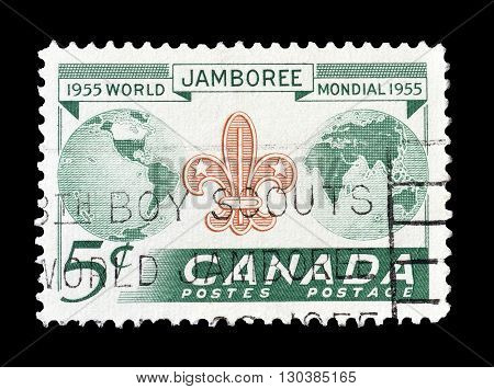 CANADA - CIRCA 1955 : Cancelled postage stamp printed by Canada, that shows Scout badge and globe.