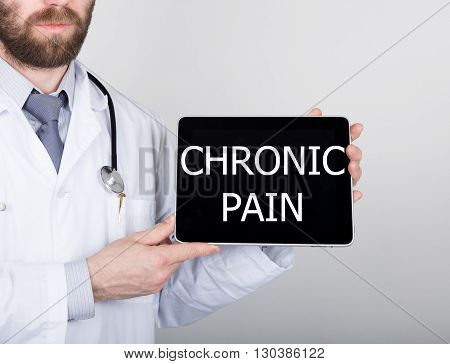 technology, internet and networking in medicine concept - Doctor holding a tablet pc with chronic pain sign. Internet technologies in medicine.
