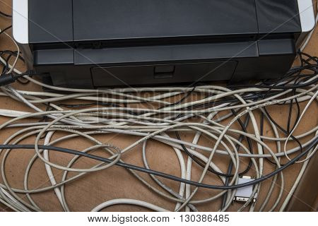 Big mess of cables on the table