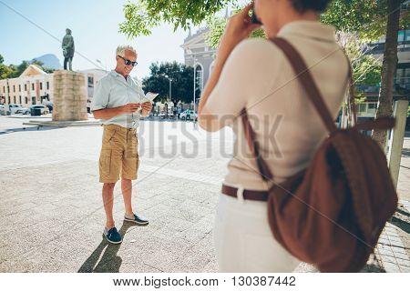 Senior Couple Taking Photos On Their Vacation