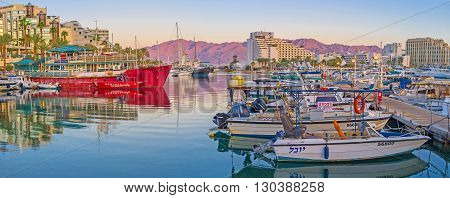 EILAT ISRAEL - FEBRUARY 23 2016: The sea trips and fishing are the most popular attractions in resort so there are always many yachts in Lagoona on February 23 in Eilat.