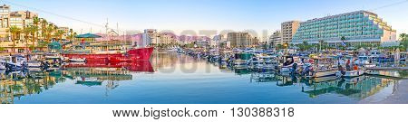 EILAT ISRAEL - FEBRUARY 23 2016: The panorama of the evening marina the yachts are reflected in clear surface of water on February 23 in Eilat.