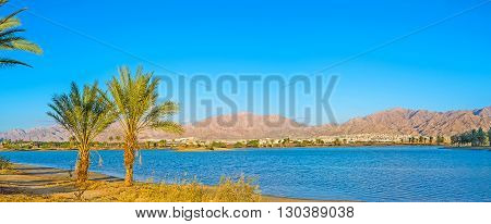 The shore of new marina with Aqaba mountains on background Eilat Israel.