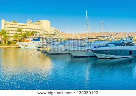 The central marina is full of luxury yachts sailing ships and small fishing boats Eilat Israel.