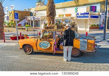 EILAT ISRAEL - FEBRUARY 24 2016: The tourist car driver waits for the clients offering an excursion in unusual car on February 24 in Eilat.