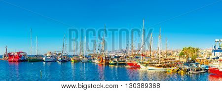 EILAT ISRAEL - FEBRUARY 24 2016: The bright colors of the morning in the port with the scenic yachts on February 24 in Eilat.