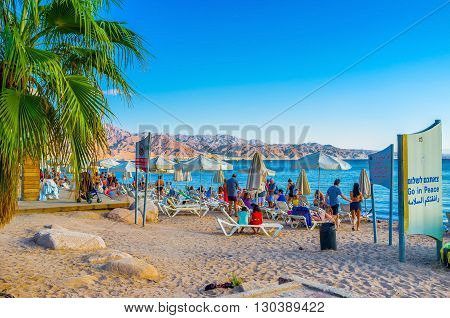 EILAT ISRAEL - FEBRUARY 23 2016: The afternoon time is the best time to relax on the beach on February 23 in Eilat.