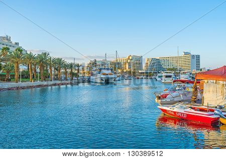 EILAT ISRAEL - FEBRUARY 23 2016: The scenic Lagoona of the luxury resort is full of yachts and pleasure boats on February 23 in Eilat.