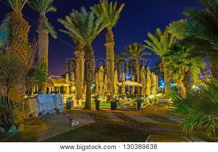 The beach restaurant hidden among the palms in beautiful garden Eilat Israel.