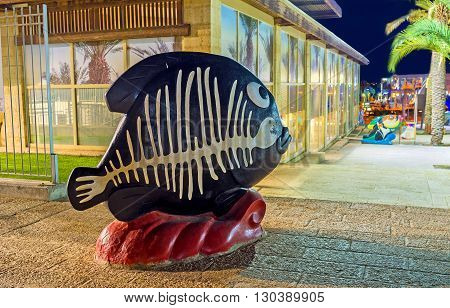 EILAT ISRAEL - FEBRUARY 23 2016: The black fish with painted white skeleton in the city square on February 23 in Eilat.