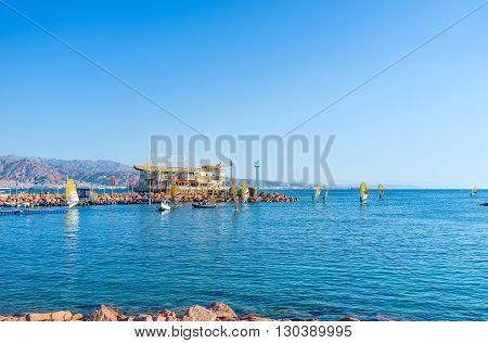 EILAT ISRAEL - FEBRUARY 23 2016: The windsurfers back to the harbor after the competitions on February 23 in Eilat.