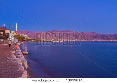 EILAT ISRAEL - FEBRUARY 24 2016: The rocky mountains of Aqaba are still red after the sunset on February 24 in Eilat.