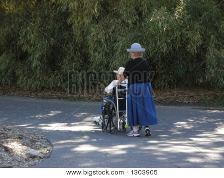 Disabled Senior Women On A Walk