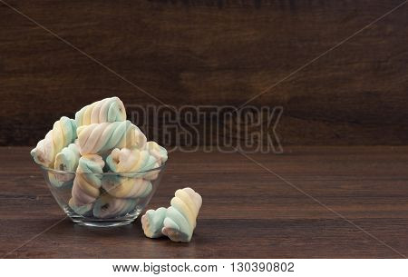 Twisted Marshmallow On Wooden Background