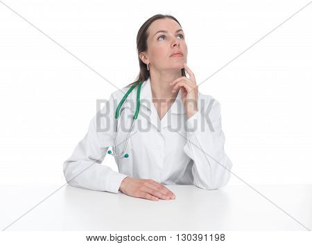 Thoughtful Female Doctor Sitting At Desk And Looking Up
