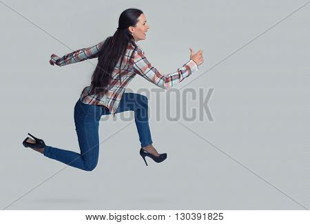 Full Length Portrait Of Woman Running Sideways