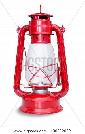 Isolated image of red kerosene lantern with glass chamber and metal frame against a white background