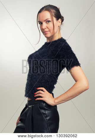 Fashionable Brunette Woman Smiling And Posing