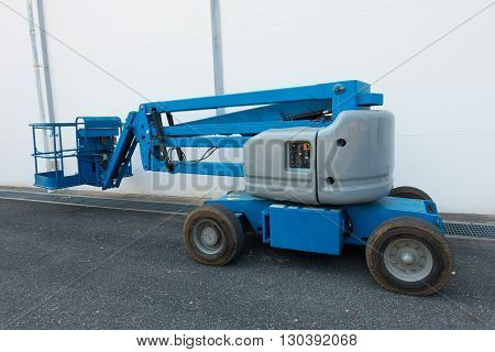 Lifting boom lift in construction site, Heavy truck.